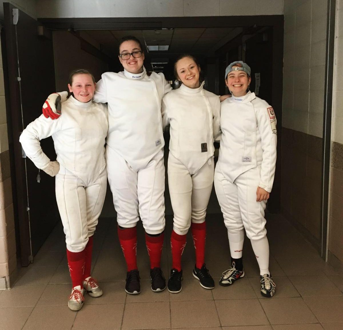 Women's Epee Squad at Team State's Competition From left to right:  Ashlyn Sminkey (upper), Cassandra Zawacki (upper), Phoebe Drupa (senior), Alex Wicken (senior)